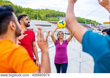 Multiethnic Team Group Playing Beach Volley On Sun Light