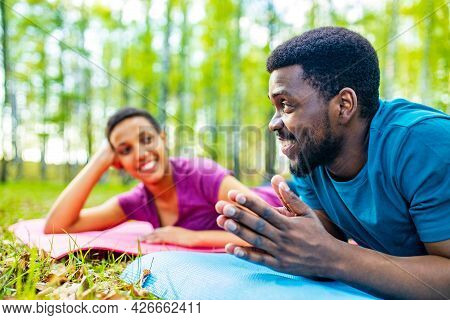 Latin American Couple Ready To Yoga Time Outdoors Pink And Blue Look