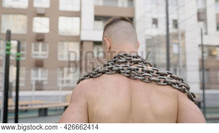 Athlete And Training Chain. Fight For Fitness. Fit Man With Metal Chain. Athletic Guy With Muscular