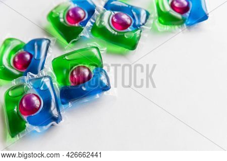 Washing Pods On White Background, Close Up, Abstract Color Background.liquid Detergent, Capsules Wit