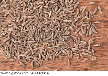 Dried Cumin Seeds On Wooden Background, Close Up, Organic Food