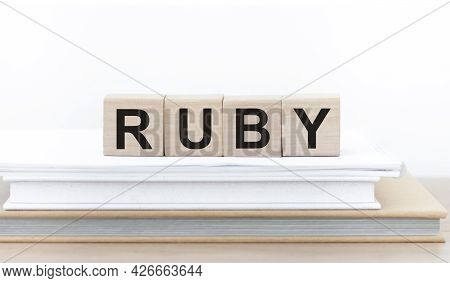 Wooden Cubes With The Word Ruby On A Stack Of Books On A Light Background