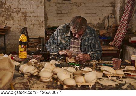Wood Artist, Craftsman, Carpenter In A Workshop For The Manufacture Of Handmade Wooden Toys. Safe Ec