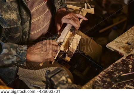 Closeup Of Carpenter Hands In Work On A Wooden Items In Workshop. Craftsman Making Handmade Craft Wo