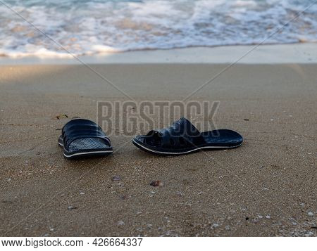 Flip Flops Slippers On The Sandy Beach. Early Morning