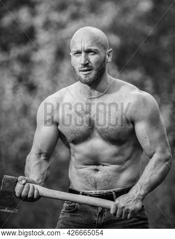 Forester With Axe. Last Man On Planet. Sexy Macho Bare Torso. Surviving In Wild Nature. Muscular Ath