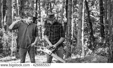 Man Farmers Relax In Forest. Rangers Use Lumberjack Equipment. Lumberjack With Saw And Ax. Harvest F