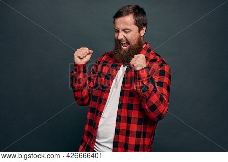Professional Success, Triumph And Overjoy Concept. Man Screaming Yes And Do Victory Dance, Celebrate