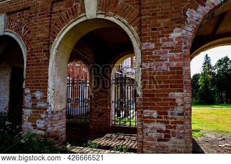 The Ensemble Of The Building Is Made Of Red Brick With Arched Passages. The Village Of Polybino, Dan