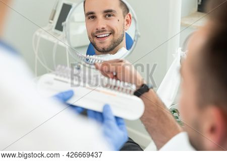 Handsome Young Man In Stomatology Clinic. Healthy Teeth Whitening.