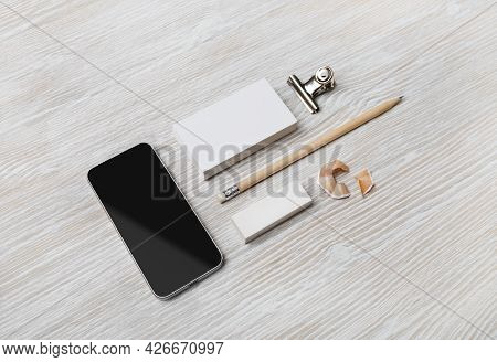 Blank Stationery And Smartphone On Light Wooden Background. Branding Mock Up. Template For Branding