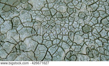 Cracked Soil - Cracked Soil Texture. Dry Soil Cracks In The Dry Season