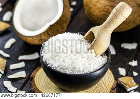 Grated Coconut In Rustic Earthenware Bowl. Tropical Fruit Cooking Ingredient