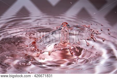Colour Splash Of A Water Drop Collision Showing Up An Inverted Cone