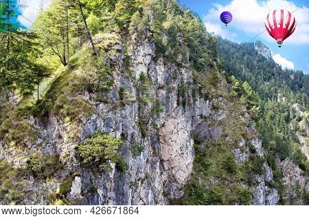 View Of High Apls Mountains Wth Hot Air Balloons In The Blue Sky.