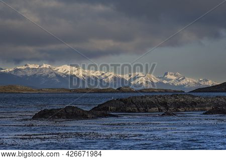 Panoramic Shot Of Ushuaian Andes Snowed Mountains Called End Of The World And In The Front A Little