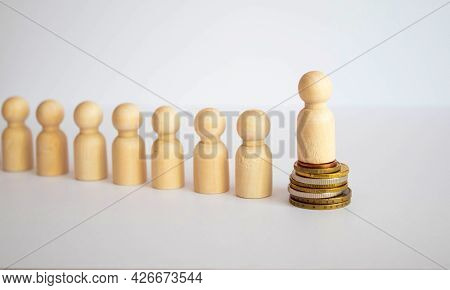 Wooden Figure Standing In Front Of The Team To Show Influence And Empowerment. Concept Of Business L