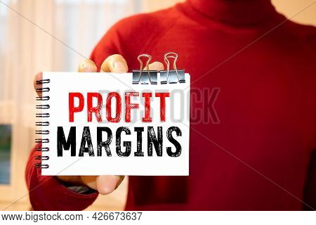 Notepads On The White Background. Text Profit Margin,