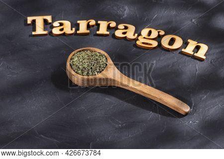 Dried Organic Tarragon Leaves In Wooden Spoon - Artemisia Dracunculus