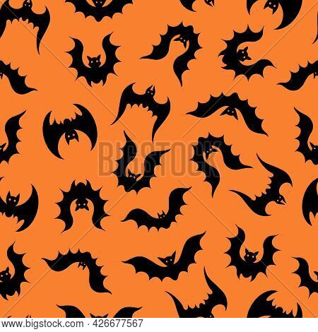 Bats Vector Seamless Pattern. A Flock Of Flying Predators On An Orange Background. Black Silhouettes