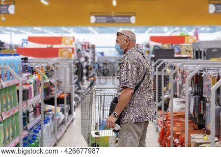A Man With A Protective Mask Chooses A Product In A Department Store