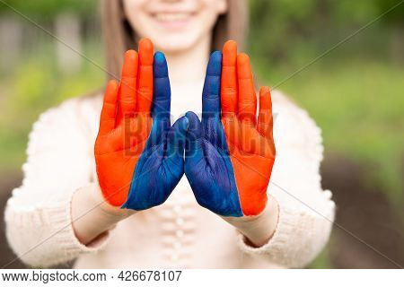 Hands Of Kid Girl Painted In Mongolia Flag Color Show Stop Gesture. Focus On Hands. July 10 National