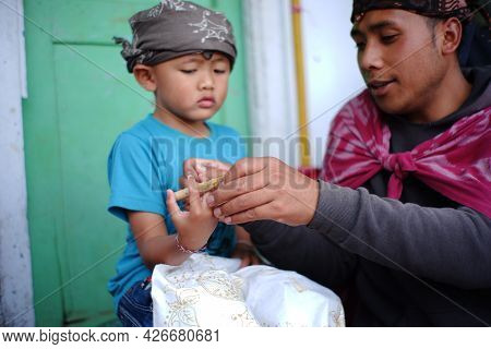 Pasuruan, Indonesia. June 2021. A Father Is Teaching His Son To Make Batik. Portrait Of The Next Gen