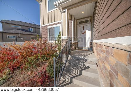 Front Porch Exterior Of A House With Messy Front Yard Garden