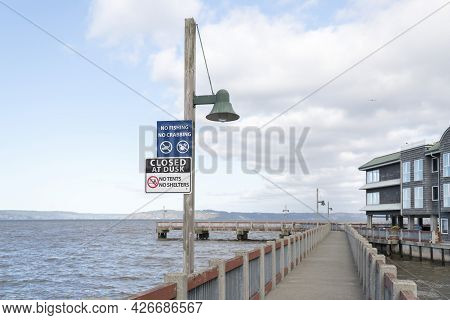 Pier At Tacoma In Washington With Public Signage On A Light Post