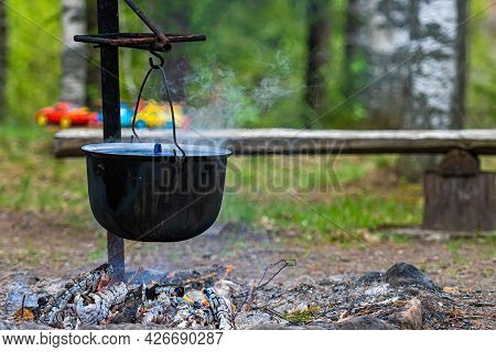 Cooking Food On A Campfire In The Woods, Food Camping Concept, Place For A Bonfire In The Rural Hous