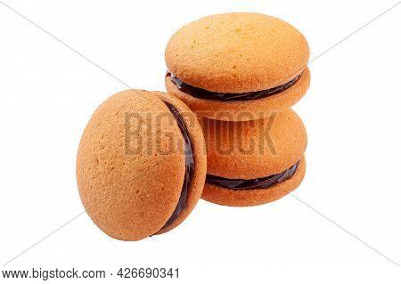 Almond Sandwich Biscuits With Chocolate Ganache On White