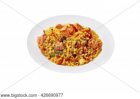 Plate Of Pilaf With Lamb, Carrot And Dried Fruits Isolated On White