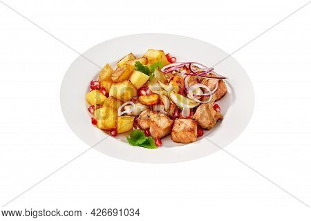 Roasted Pork And Potatoes With Pomegranate Seeds Isolated On White