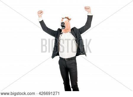 Hard Work Spells Success. Businessman Wear Horse Head Mask With Raised Arms. Enjoying Success