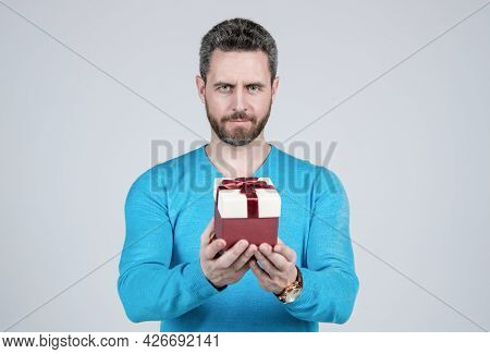 Successful Guy Holding Giftbox. Handsome Man Prepare For Romance Date. Man With Business Reward