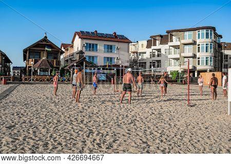 Zaliznyi Port, Ukraine - July 23, 2020: Young People Play Beach Volleyball On The Beach In The Ukrai