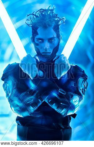Warrior of the future. A brave cyberpunk warrior in protective uniform poses  in neon light. Game, virtual reality.