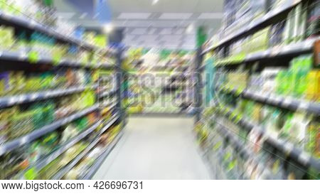Abstract Blur Image Of Supermarket Background. Defocused Shelves With Products. Grocery Shopping. St