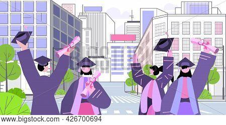 Graduated Students On City Street Graduates Celebrating Academic Diploma Degree Education Concept