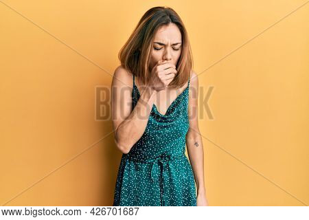 Young caucasian blonde woman wearing elegant party dress feeling unwell and coughing as symptom for cold or bronchitis. health care concept.