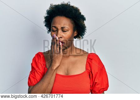 Young african american woman wearing casual clothes bored yawning tired covering mouth with hand. restless and sleepiness.