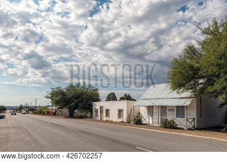 Prince Albert, South Africa - April 20, 2021: A Street Scene, With The Main Street And Houses, In Pr