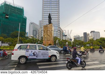 Ho Chi Minh, Vietnam - Oct 18, 2019 : View Of Tran Hung Dao Statue With Many Cars And Bike In The Fo
