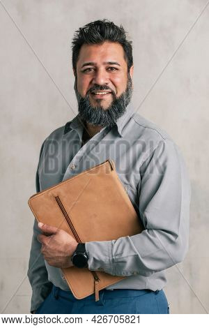 Smart Indian man carrying a laptop pouch