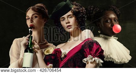 Medieval Women As A Historical Persons In Vintage Clothing On Dark Background. Concept Of Comparison