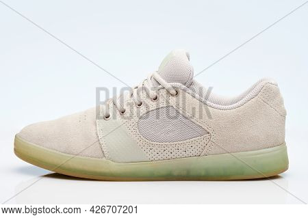One Gray Casual Sneaker Shoe Side View Isolated