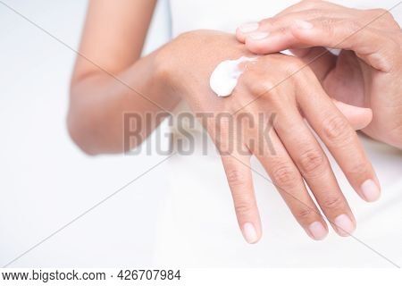 Woman Applying Lotion Body On Hand Close Up On White Background. Authentic Slim Fit And Skin Tan. Cr