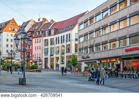 Nuremberg, Germany - May 17, 2016:  Street in the old town of Nuremberg with walking people in the evening