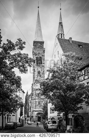 Nuremberg, Germany - May 17, 2016: Street and St. Sebaldus Church in Nuremberg. Black and white german cityscape