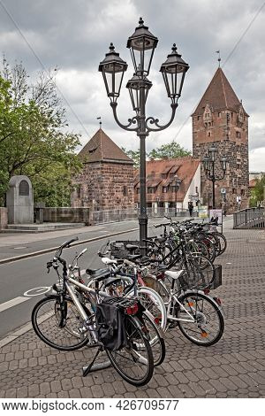 Nuremberg, Germany - May 17, 2016:  Street in the old town of Nuremberg with parked bicycles